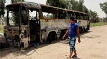 At least 60 killed in attack on Iraq prison convoy
