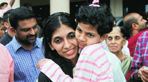 Indian nurse Merina Jose with her daughter after returning from Iraq, in Kochi on Saturday. (Reuters)