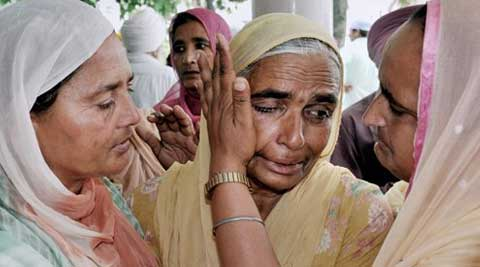 A relative is consoled during a prayer meeting for the Indian workers stranded in Iraq, at Baba Budha Ji Sahib Gurdwara at Kathunangal in Amritsar. (Source: PTI)