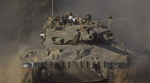 Israeli soldiers drive a tank to a position near Israel Gaza Border. (Source: AP)