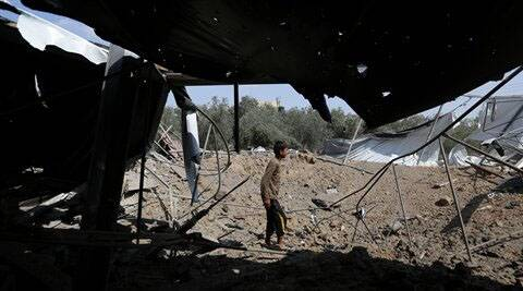 Palestinians inspect the rubble of a house after it was hit by an Israeli missile strike in Rafah, southern Gaza Strip. (Source: AP)