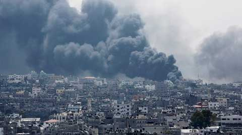Smoke rises after an Israeli missile hit Shijaiyah neighborhood in Gaza City, northern Gaza Strip. (Source: AP)