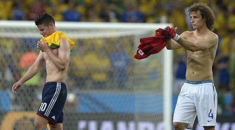 Brazil's David Luiz, right, applauds Colombia's James Rodriguez at the end of the match (Source: AP)