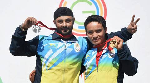 Jitu Rai (R) and Gurpal Singh (L) with their medals at the medal ceremony of the 50m pistol event in Glasgow on Monday. (Source: PTI)