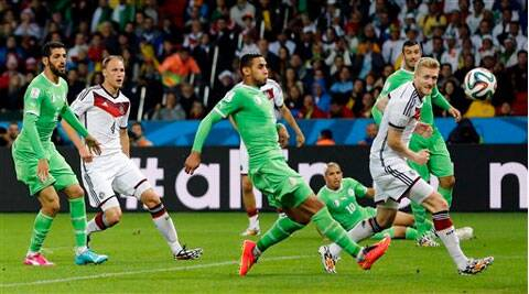 Germany's Andre Schuerrle, right, scores the opening goal during the World Cup round of 16 soccer match between Germany and Algeria. (Source: AP )