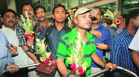 Indian workers return from Iraq, at Kolkata Airport, Tuesday night. ( Source: Express photo by Subham Dutta )