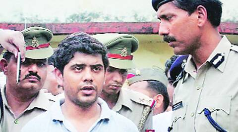 Businessman Piyush Shyam Dashani in police custody for plotting the murder of his wife, in Kanpur, Tuesday. (Below) Driver AwadheshSource: PTI