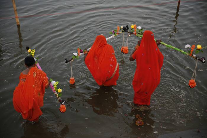 Women pilgrims fill water from the River Ganga in Allahabad. (Source: AP)
