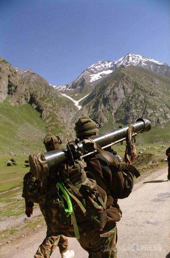 Soldiers carrying weapons during the Kargil war. (Source: Express archive photo)