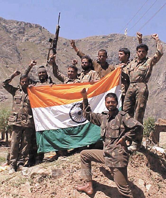 The iconic moment when the Indian army reclaimed its position on the Tiger Hills in the 1999 Kargil War, after almost two and half months of conflict with Pakistan.<br />As the country marks the 15th anniversary of its triumph in Kargil War, here's a flashback. (Source: Express archive photo)