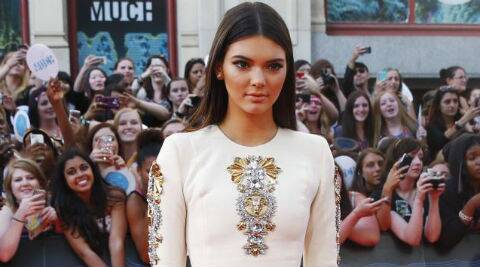 Kendall Jenner has been linked to rapper Young Jinsu and One Direction's Harry Styles. (Source: AP)