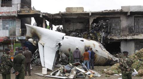 The plane transporting the mild stimulant known as Khat to the Somali capital, Mogadishu, crashed into a commercial building after taking off from Jomo Kenyatta International Airport early Wednesday. (Source: AP)