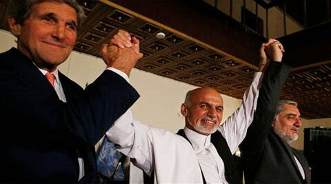 U.S. Secretary of State John Kerry, left, and Afghanistan's presidential candidates Ashraf Ghani, centre, and Abdulah Abdullah hold their arms in the air together after announcing a deal for the auditing of all Afghan election votes at the United Nations Compound in Kabul. (Source: AP)