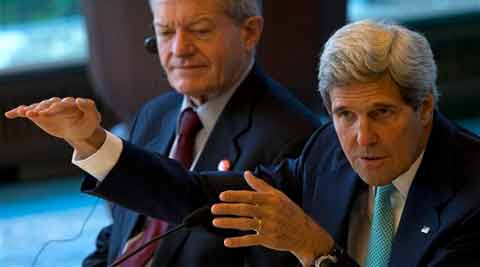U.S. Secretary of State John Kerry, right, speaks at a breakfast meeting attended by Chinese and American entrepreneurs during the U.S.-China Strategic and Economic Dialogue at the Diaoyutai State Guesthouse in Beijing. (Source: AP)