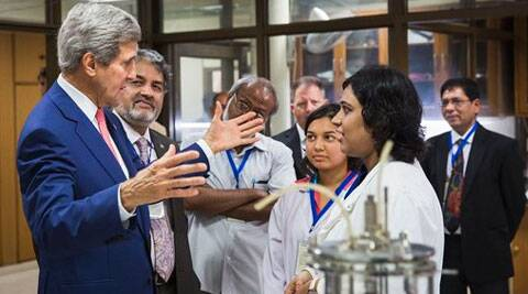 U.S. Secretary of State, John Kerry, speaks with graduate students about their work at the Indian Institute of Technology in in New Delhi. (Source: AP photo)