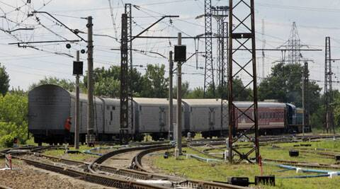 A refrigerated train loaded with bodies of the passengers of Malaysian Airlines flight MH17 departs Kharkiv railway station, Ukraine. (Source: AP)