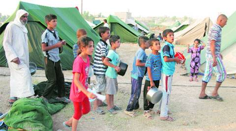 Displaced Iraqi children wait for food distribution at a camp in Khanaqin. ( Source: AP )