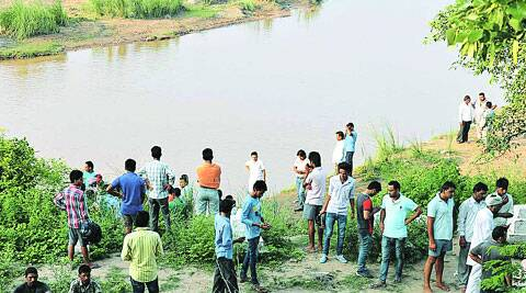 Locals at Ghaggar river bank where two boys drowned in Derabassi  on Wednesday. ( Source: Express photo by  Harjeet Singh )