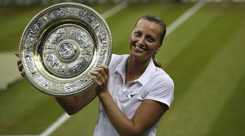 The 24 year old Czech poses with her second Wimbledon title she won it back in 2011. (Source: AP)