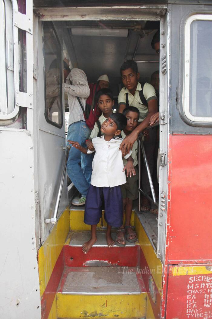 Lakhan Savant Kale, the boy whose picture showing him tied to a bus stop made news, on his first day of school at Samata Shikshan Prasarak Manda in Mumbai. (Source: Express photo by Vasant Prabhu)