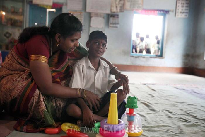 Lakhan, seen here with a caretaker, plays at the school. (Source: Express photo by Vasant Prabhu)