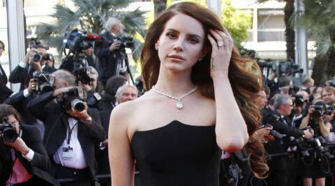 Lana Del Rey will face stiff competition for the coveted job from British singer Sam Smith. (source: Reuters)