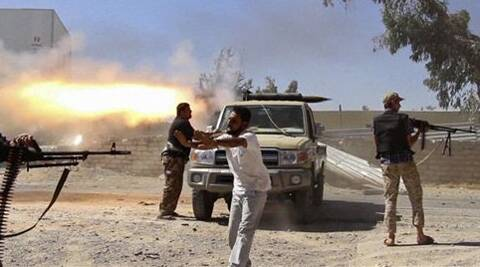 In this Saturday, July 26, 2014 frame grab from video obtained from a freelance journalist traveling with the Misarata brigade, fighters from the Islamist Misarata brigade fire towards Tripoli airport in an attempt to wrest control from a powerful rival militia, in Tripoli, Libya. (Source: AP)