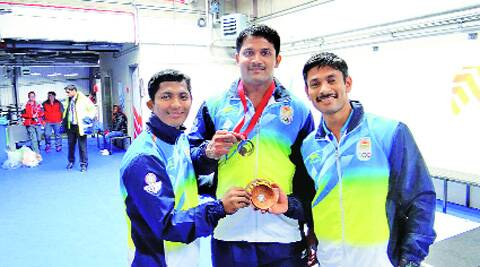 (From left) Ganesh Mali, Chandrakant Mali and Omkar Otari with their bronze medals at the Glasgow Games. Source: Express Photo