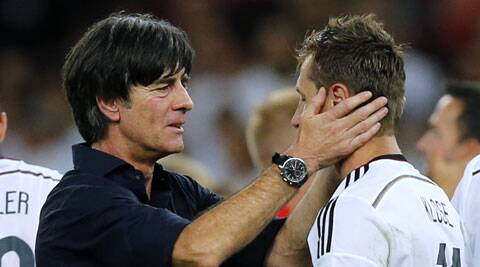 Germany coach Loew celebrates the final win with Klose (Source: AP)