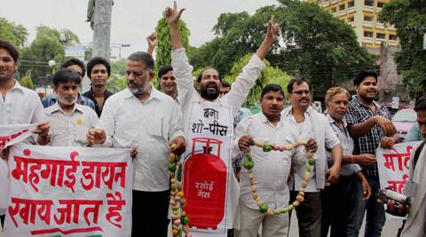 Congress Party workers protest against price hike of fuels, LPG and vegetables in Allahabad on Wednesday. (PTI)