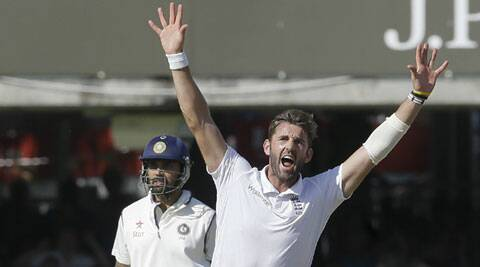 Murali Vijay looks on in the background as Liam Plunkett celebrates the wicket of Virat Kohli during the third day of the second Test at Lord's on Saturday. (Source: AP)