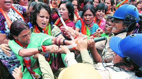 Activists of BJP's women wing protest outside the state Assembly, in Lucknow on Monday. (Vishal Srivastav)