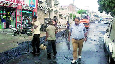 During road re-carpeting in Model Town, Ludhiana, on Monday. (Express)