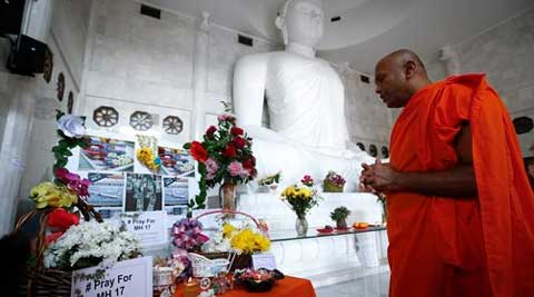 A monk prays during a special prayer for the victims of Malaysia Airlines Flight 17, Malaysia on Sunday. (Source: AP)