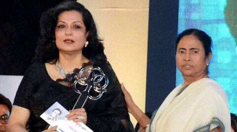 West Bengal Chief Minister Mamata Banerjee presents an award to veteran actress Moushumi Chatterjee during a function 34th death aniversary of actor Uttam Kumar in Kolkata on Thursday. (PTI)