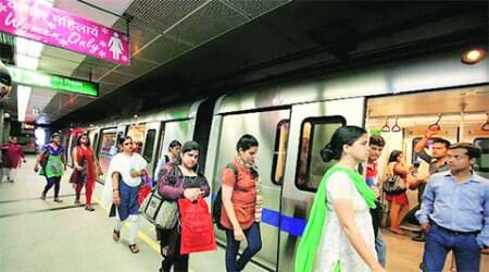 Commuters at the newly opened Mandi House Metro station. (Source: Express)