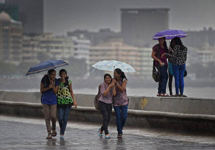 College girls enjoy the rains in Mumbai. (Source: PTI)