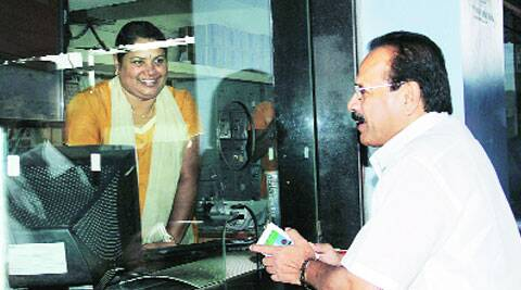 Sadananda Gowda talks to a staff member during a visit to the city railway station in Bangalore on Sunday.