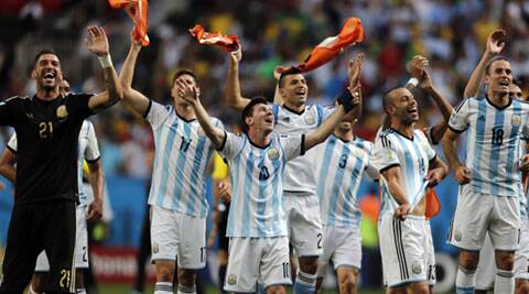 A jubilant Argentine teams waves to the fans at the stadium after their victory over Belgium. (Source: AP)