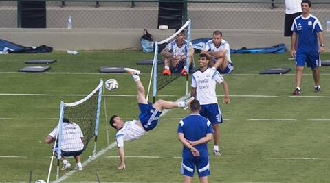 Lionel Messi hits an overhead kick during training in Vespesiano, near Belo Horizonte. On Sunday, Argentina face Germany in the World Cup final in Rio de Janeiro. (Source: AP)