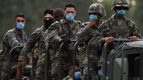 Mexican army wearing surgical masks. (Source: Reuters)