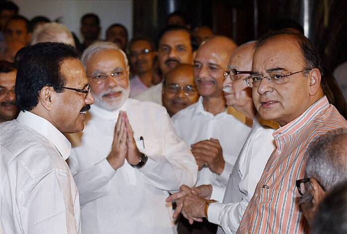 Narender Modi with senior leader L K Advani with Finance Minister Arun Jaitley and Railway Minister Sadananda Gowda. (Source: PTI)