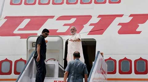 Prime Minister Narendra Modi waves as he leaves for Brazil to attend the five-nation BRICS summit. (Source: PTI)