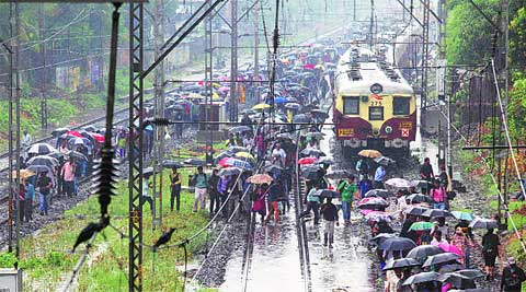 Stranded commuters near Sion station. ( Express photo by Prashant Nadkar )