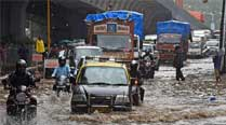 Heavy rains cause traffic snarls, local trainsdisrupted
