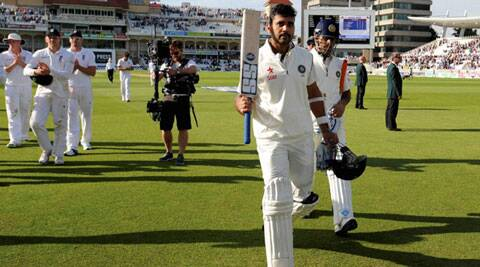 Murali Vijay walks back to the hut after scoring an unbeaten 122 on the first day of the Trent Bridge Test (Source: AP)