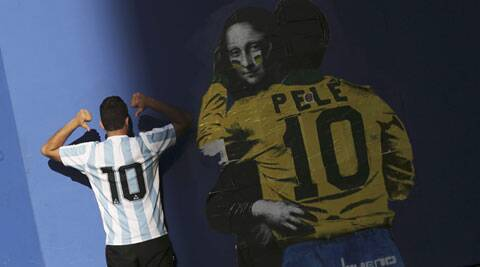 An Argentine fan poses in front of a mural in Sao Paulo. (Source: Reuters)