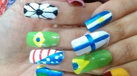 Girls sporting FIFA-inspired nail art which is fast catching up among the youth Source: IANS