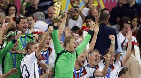 Manuel Neuer lifts the trophy amid his teammates (Source: AP)