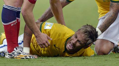 Neymar was ruled out of the rest of the World Cup after being kneed in the back late in Brazil's 2-1 quarterfinal victory over Colombia. (Source: AP)